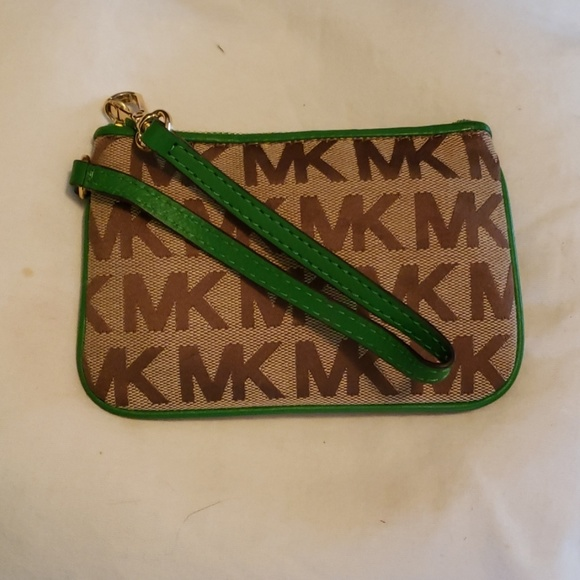 Michael Kors Handbags - 👉PRICE DROPPED👈Authentic  Michael Kors  Wristlet